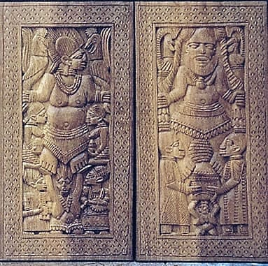 Wooden shutters based on doors of Yoruba gods and godesses.