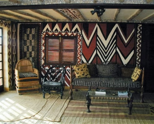 African Heritage House roof room with wall design taken from Maasai shields.
