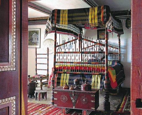 Lamu suite with 19th century Swahili bed.