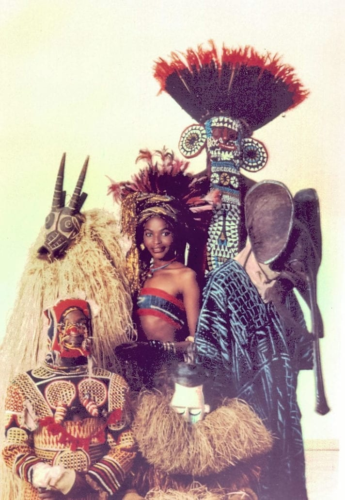 African Heritage models with masks.