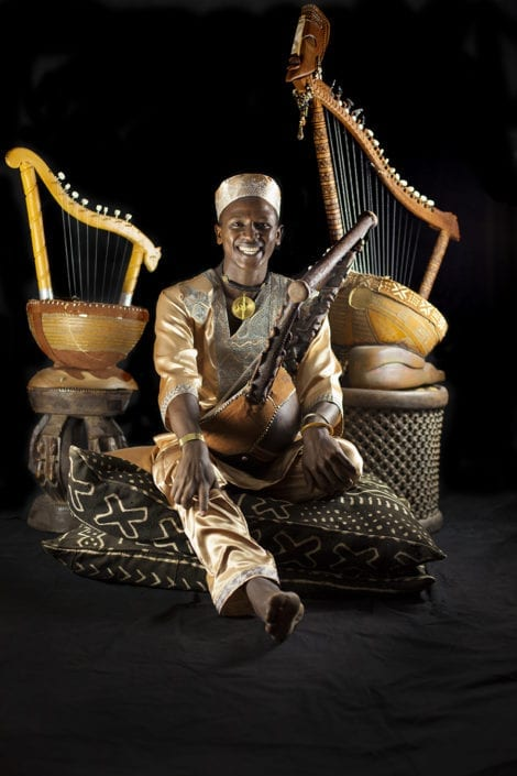 Papillon with three of his hand-made instruments. Photo by Heléne Wikström.
