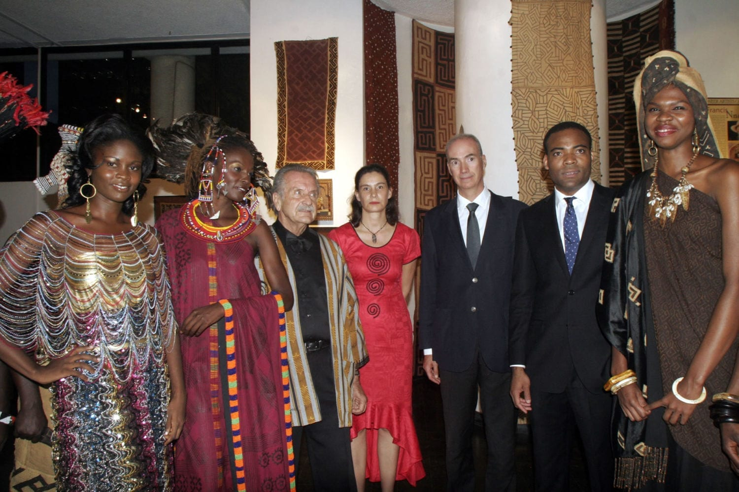 Alan Donovan (third left) with the Guest of Honour for the African Heritage 40th Anniversary Celebrations, Prince Kwete Kwete of the Kingdom of Kuba (DRC), second from right, with French Ambassador to Kenya, Director of French Cultural Centre, and models in original African Heritage designs of authentic African textiles by Alan Donovan.