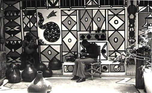 The African Heritage Garden Craft Center on Kenyatta Avenue modelled on an Ibo Shrine in Nigeria by artist Carol Beckwith with craftspeople at work. The Craft Centre was attached to a Pan African Restaurant first opened by famed restauranteurs Omar el Haj and Rolf Schmidt, later it changed to Ethiopian cuisine.