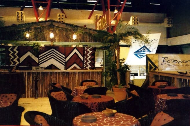 Design for Kenya at the World Travel Mart in Germany with mural painted in Maasai shield design like roof room of African Heritage House.