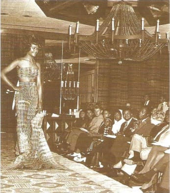 Seychelloise model Bertha August showing embroidered Nigerian tie-dye as the Nigerian high commissioner and Kenyan ministers Mwai Kibaki and Dr. Njoroge Mungai look on.